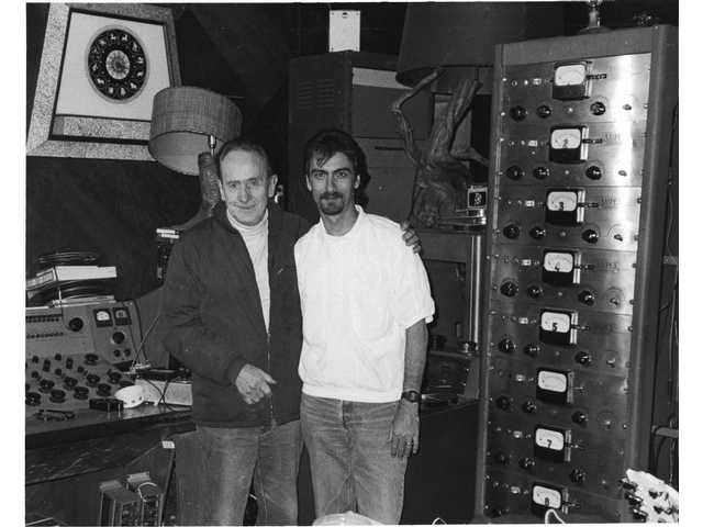 "The world's first eight-track recording machine, built by Ampex in the mid-1950s per Les Paul's specs, is among the artifacts in Paul's recording studio, where the inventor, pictured at left, and the author, pictured at right, taped an eight-hour interview in 1991. This revolutionary machine marked the dawn of modern recording. Without multitrack recording, The Beatles could never have recorded ""Sgt. Pepper's Lonely Hearts Club Band,"" one reason Paul McCartney is such a Les Paul fan."