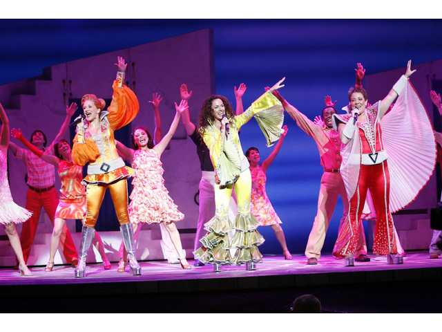 "The cast of the national tour of ""Mamma Mia!"" lights up the stage with familiar ABBA tunes connecting the simple storyline of family, love and friendship. The show runs through April 19 at the Pantages."