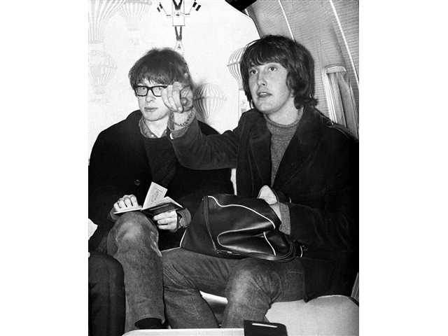 In this April 21, 1965 file photo, British pop duo Gordon Waller, right, and Peter Asher, known as Peter and Gordon, are pictured before departing London for Tokyo on tour. Waller, who had a string of hits in the 1960s including several written by Paul McCartney, died Friday, July 17, 2009. He was 64.