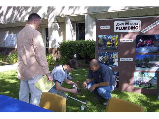 Visitors to the 2008 Discovering Careers Expo participate in a hands-on activity sponsored by presented John Murray Plumbing. The company will host a booth again this year.