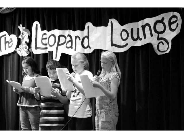 Youngsters perform their favorite poetry during Live Oak Elementary School's 6th annual Poetry Night lastweek. Timed to coincide with national turn-off-the-TV week, the event staged for family and friends helpedbring families together and encouraged youngsters to speak to groups in public, an organizer said.