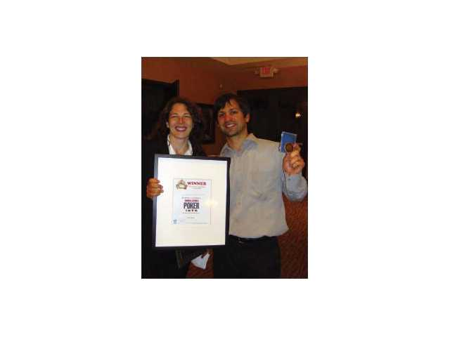Dr. Amy Wagner and her husband Paola Hernandez celebrate Wagner's win at the Soroptomist International of Santa Clarita Valley's first annual Fiesta Poker Texas Hold 'em Tournament on June 6 at the Westridge Horizon Clubhouse.  Wagner's prize was a $1,500 seat at the June 25 and 26 World Series of Poker in Las Vegas, including hotel room.