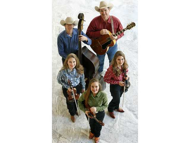 The Quebe Sisters Band, 2008 (counterclockwise, from left): Sophia, Hulda and Grace Quebe; Joey McKenzie; and Drew Phelps.