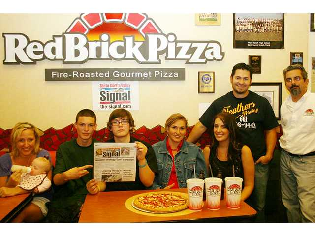 The Signal and Red Brick Pizza in Valencia threw a pizza party Thursday night for The Signal's 500th and 1,000th Facebook friends. The winners were treated to free family special dinners compliments of Red Brick. From left: Wendy Boloz (No. 500) with daughter Samantha; Juan Pablo, Daniel and Gladys Hoyos; Michelle Winston; David Hoyos (No. 1,000); and Eddie Kaladjikian, Red Brick Pizza partner.