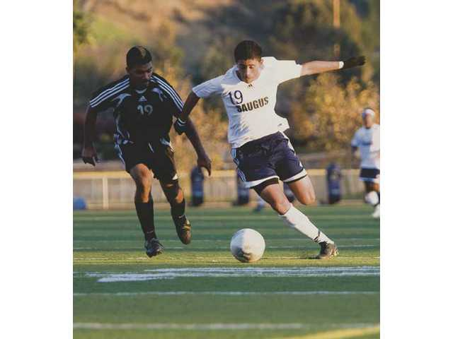 Saugus striker Erick Esquivel (19) makes a run down the left flank earlier this season. Esquivel will be among those counted on to provide the Centurions with a scoring punch.