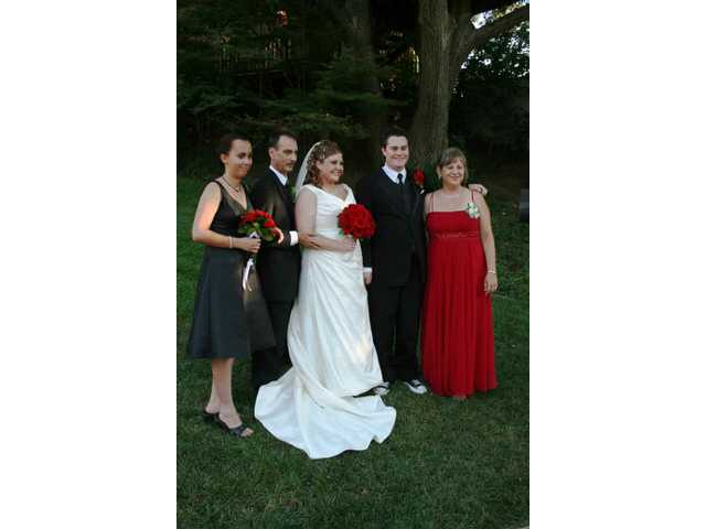 The Peeples family joined the bride and groom (from left): Veronica Joan and Stephen K. Peeples; Nadine A. Martini-Peeples.