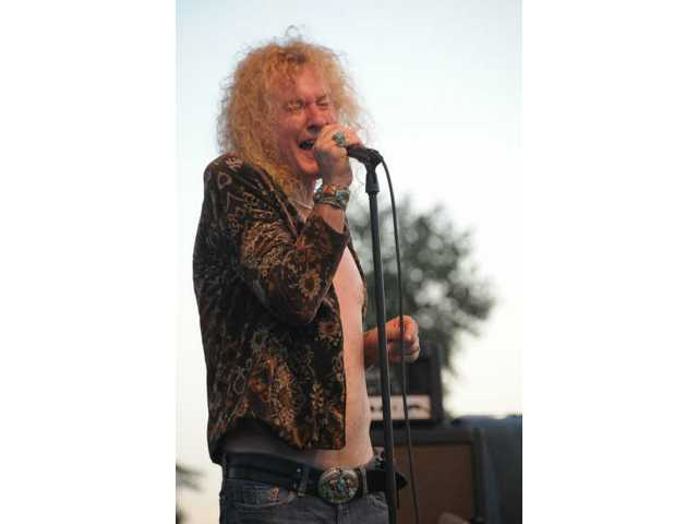 Led Zepagain's Swan Montgomery conjures up the sight and sound of Led Zeppelin lead singer Robert Plant once again for Zepagain's Concert in the Park performance July 18.