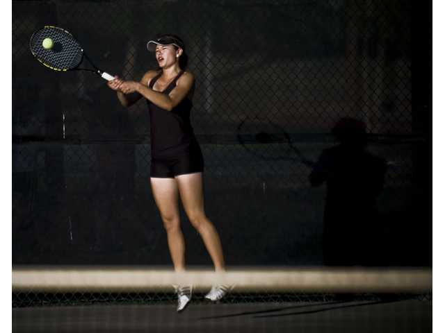Thalia Wilczinski smashes a tennis ball Thursday in her second game of the day against Santiago High of Corona at Valencia High.