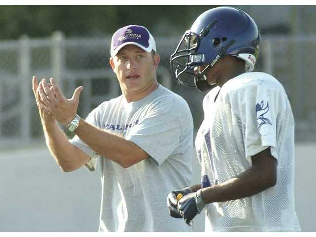 Valencia defensive coordinator Robert Waters instructs a Valencia player during training camp Wednesday at Valencia High School.