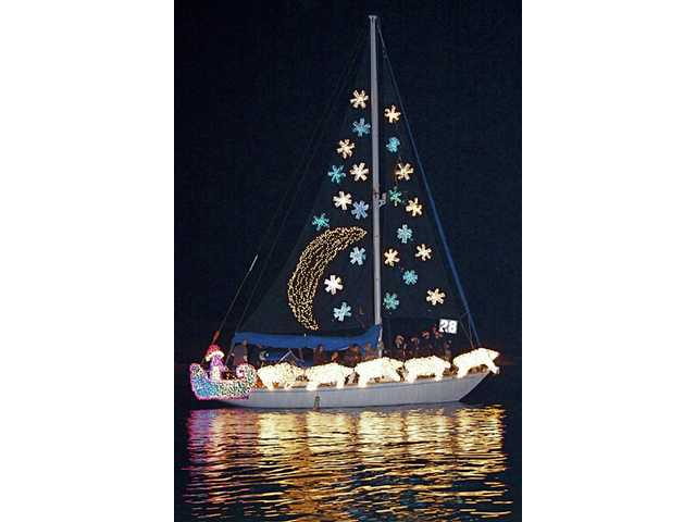 A decorated sailboat cruises in a recent Ventura Harbor Holiday Boat Parade. This year's event takes place Dec. 19 and 20. In addition to the watercraft cavalcade, a special Christmas carnival and a fireworks display will take place.