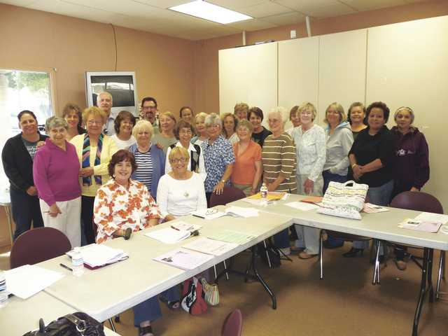 New graduates of the Santa Clarita Valley Senior Center's Volunteer Peer Counselor Program pose with Supportive Services Director SuzAnn Nelsen, seated front left, and Judith Harris, seated front right, the psychotherapist who facilitated the in-depth three-session training program.
