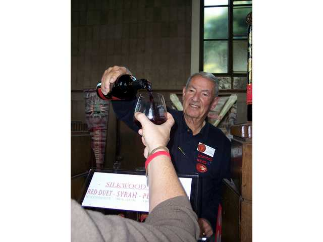 John Monnich of Silkwood Wines pours a petit syrah for a guest at the Loose Goose event. The celebration featured 27 wineries and one beer, Stella Artois.