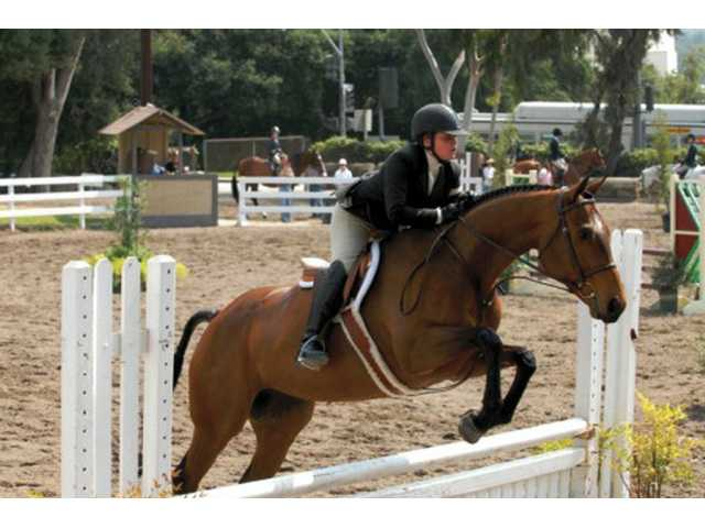 Ashlyn Matheus, 13, and her horse Perfect Summer Day took first place at the Riding for Reading competition at the Los Angeles Equestrian Center on Sept. 1.