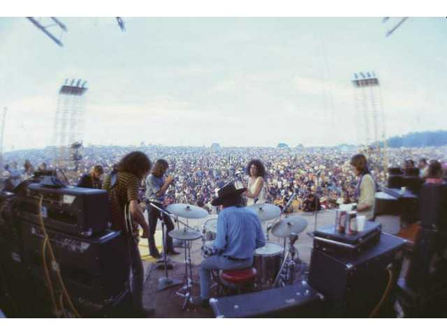 """Jefferson Airplane brings San Francisco's sound to the Woodstock Music & Art Fair Aug. 15, 16 and 17, 1969, in White Lake, N.Y. as seen in a photo from """"The Woodstock Experience"""" by Michael Lang and Henry Diltz, released in June 2009 by Genesis Publications to mark Woodstock's 40th anniversary."""