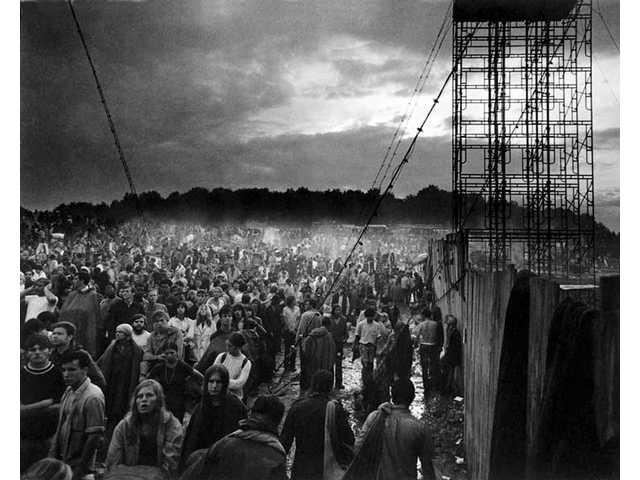 """Intermittent heavy rain soaked 400,000 music fans at the Woodstock Music & Art Fair Aug. 15, 16 and 17, 1969, in White Lake, N.Y. as seen in a photo from """"The Woodstock Experience"""" by Michael Lang and Henry Diltz, released by Genesis Publications in June 2009 to mark Woodstock's 40th anniversary."""