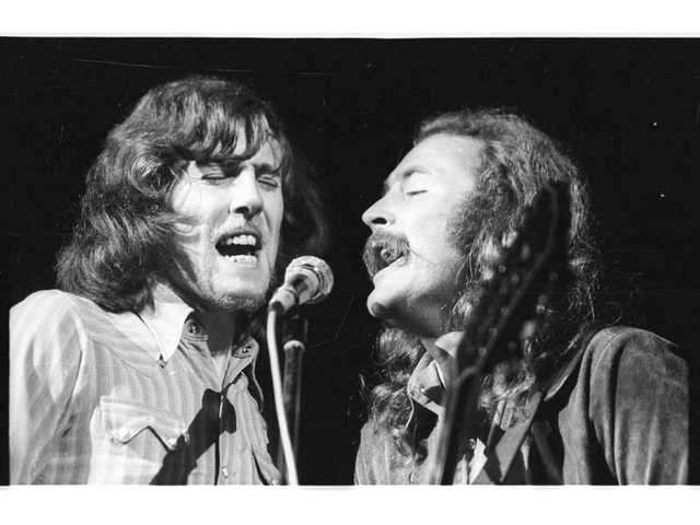 """Graham Nash and David Crosby of Crosby, Stills & Nash blend harmonies one of their first gigs in public at the Woodstock Music & Art Fair in White Lake, N.Y., as seen in a photo from """"The Woodstock Experience"""" by Michael Lang and Henry Diltz, released by Genesis Publications in June 2009 to mark Woodstock's 40th anniversary."""