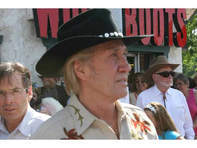 Actor David Carradine, accompanied by his brother Robert (left), arrives on Main Street in Old Town Newhall for his Walk of Western Stars plaque dedication ceremony April 25, 2008.