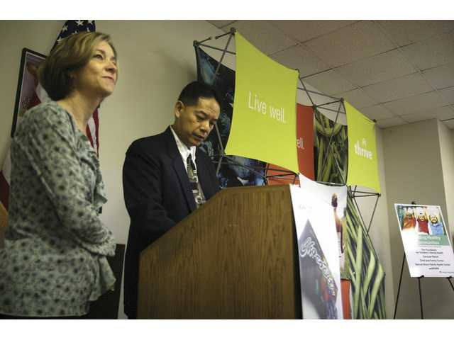 Left to right: Department administrator Debbie Meschkay, RN, and Dr. David Wong talk about local nonprofit organizations to which Kaiser Permanente has donated a collective $40,000, Wednesday at Kaiser Valencia.