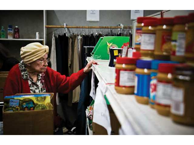 Malinda White a 95 year old from Canyon Country shops at the Hunger Defense funds donation center in Canyon Country.