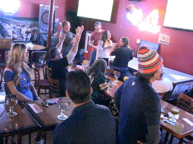 <p>Patrons cheer as they watch Super Bowl 50 at Schoonerville sports bar on Bouquet Canyon Road.  Video still by Austin Westfall, The Signal.</p>