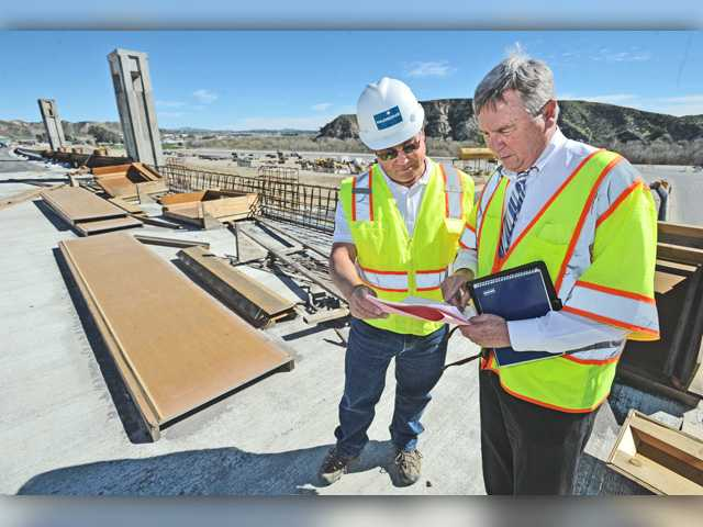 <p>A new bridge that will carry commuters on Highway 126 over Commerce Center Drive in Castaic will partially open to traffic in a few weeks, officials said Wednesday.</p>