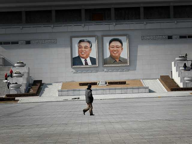 <p>A man walks past portraits of the late North Korean leaders Kim Il Sung and Kim Jong Il, at the Kim Il Sung Square on Sunday, Feb. 14, 2016, in Pyongyang, North Korea. </p>