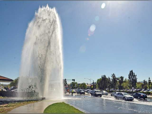 Sheared fire hydrant powers some 50,000 gallons down drain