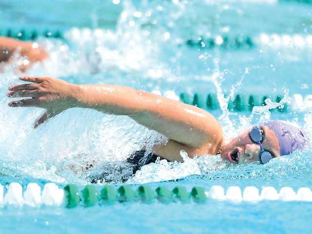Valencia boys, girls swim sweeps Hart