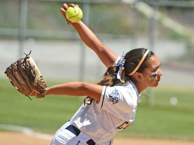 <p>College of the Canyons pitcher Milana Casillas delivers a pitch against Cerritos College at COC on Saturday. Signal photo by Dan Watson</p>