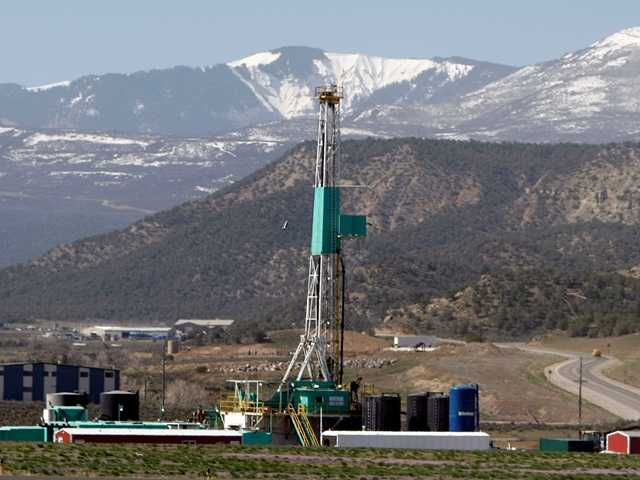 <p>A natural gas well pad sits in front of the Roan Plateau near the Colorado mountain community of Rifle, Colo.</p>