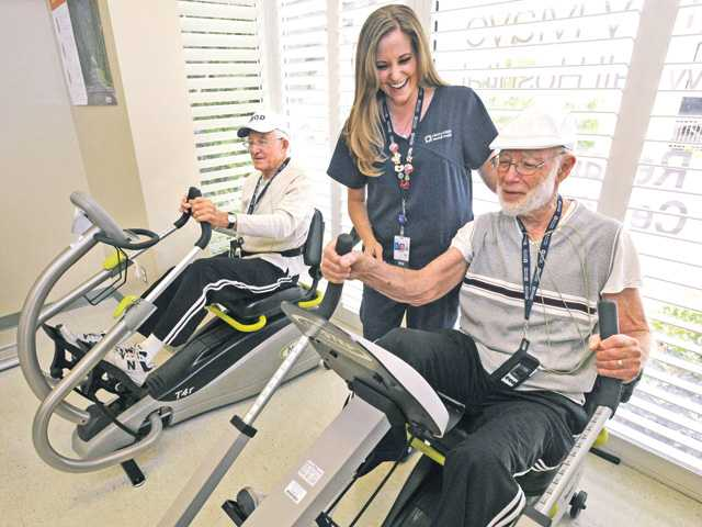 "<p>Bob Blumenhein, 81, foreground, and Erwin Malowe, 80, get a cardio workout on the ""arm ergometer"" at the Henry Mayo Newhall Hospital Cardiac Rehabilitation Center in Valencia. At center is RN Krista Dall. Signal photo by Dan Watson</p>"