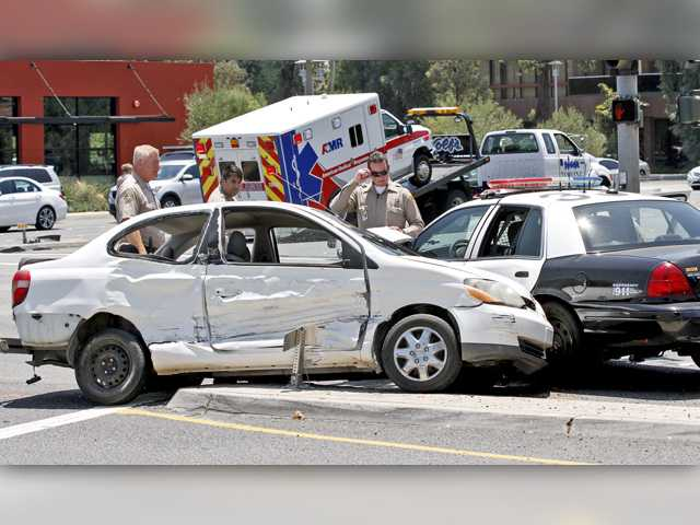 <p>Three people were transported to a hospital Wednesday afternoon following a crash involving a Los Angeles County Sheriff's Department patrol car, an American Medical Response ambulance and a Toyota car in Santa Clarita.</p>