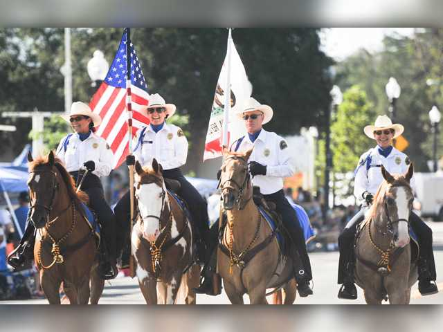 <p>Cheered on by crowds waving flags and lounging in lawn chairs, the annual Independence Day parade is scheduled to again wend its way through the streets of downtown Newhall this year on July 4.</p>
