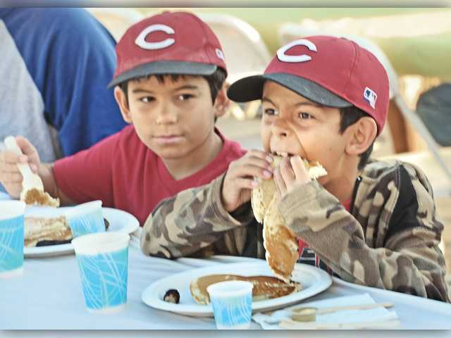 <p><span>Hundreds of hungry residents, many with kids, loaded up their plates and slathered on the syrup this morning at the Santa Clarita Valley Rotary Club's annual Fourth of July pancake breakfast.</span></p>