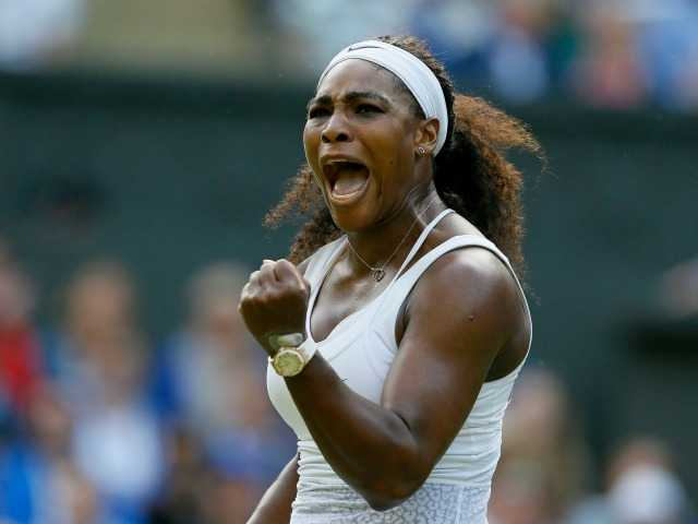 <p>Serena Williams of the United States celebrates after winning a point against Heather Watson of Britain during their singles match at the All England Lawn Tennis Championships in Wimbledon, London, Friday.</p>