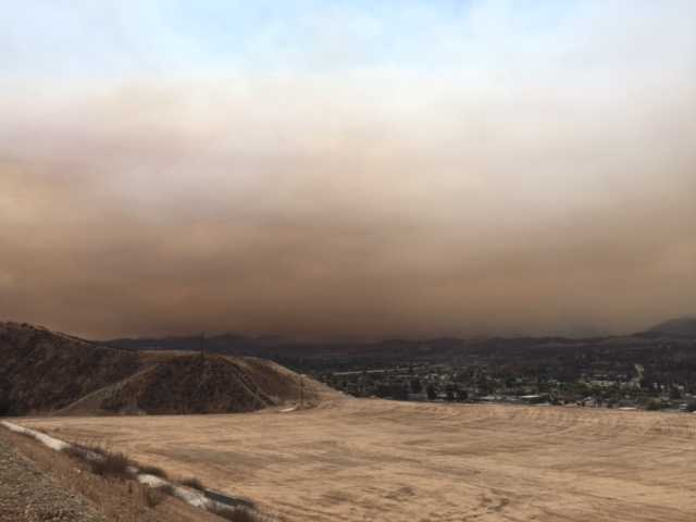<p><span>Smoke hangs over the Santa Clarita Valley Saturday morning in this photo taken on Golden Valley Road at Five Knolls.<br /></span></p>