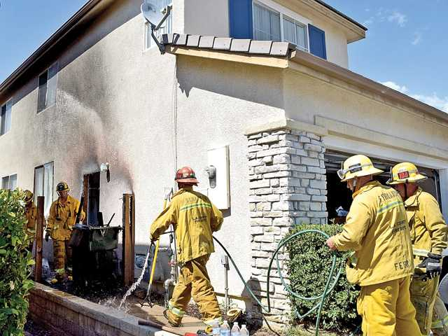 <p><span>A fire that broke out in a garage of a two-story house in Fair Oaks Ranch was quickly doused by firefighters in a matter of minutes Wednesday</span>.</p>