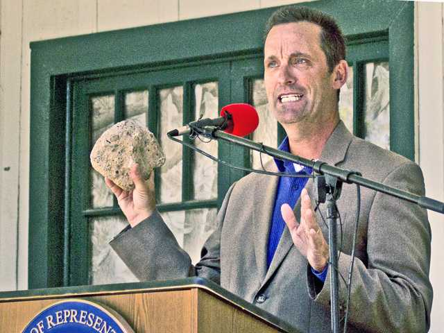<p>Congressman Steve Knight, R-Palmdale, holds up a piece of the St. Francis Dam as he talks about legislation he introduced for a national monument at the site where the dam failed 87 years ago, killing an estimated 400-600 people as a wall of water rampaged from San Francisquito Canyon to the Pacific Ocean. Signal photo by Luke Money</p>