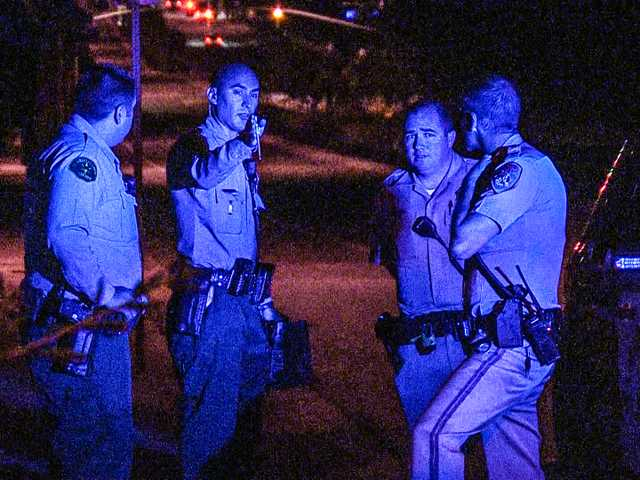 """<p><span>Santa Clarita Valley Sheriff's Station deputies brief officers from the California Highway Patrol on a weapon</span><span class=""""s1"""">allegedly</span><span>tossed out of a car window by a pursuit suspect in Newhall Tuesday night.</span></p>"""