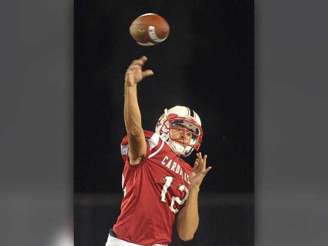 <p>Santa Clarita Christian quarterback Tristan Miller (12) passes against Blair High at Canyon High School on Saturday. Miller finished with six touchdown passes in his varsity debut.</p>