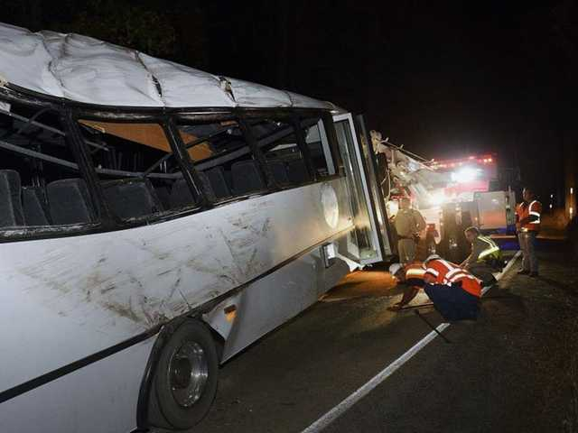 <p>Rescuers work the scene of an accident after a tour bus carrying students from China hit a tree near Yosemite National Park on Saturday.<span>Authorities say the bus was going too fast around a curve when it went off the road, killing a 13-year-old passenger.</span></p>