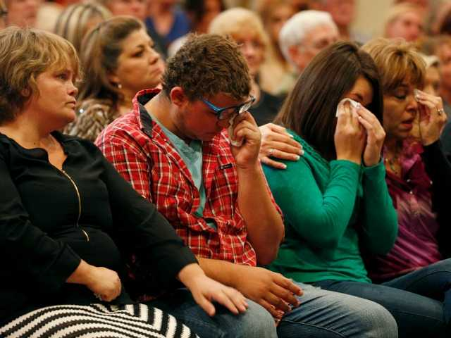 <p>From left, Summer Smith, Mathew Downing, Lacey Scroggins and Lisa Scroggins react during a church service at the New Beginnings Church of God, Sunday, Oct. 4, 2015, in Roseburg, Ore.</p>