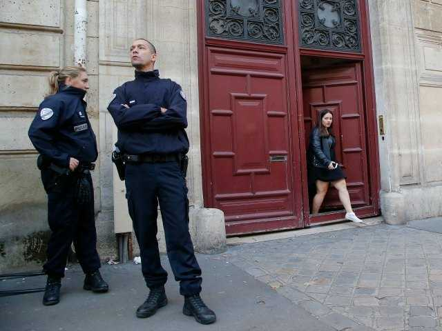<p>French police officers stand outside the residence of Kim Kardashian West in Paris Monday, Oct. 3, 2016.</p>