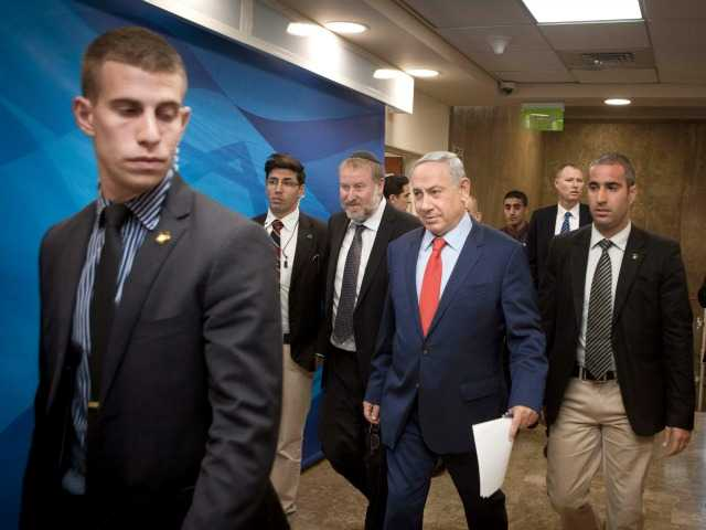 <p>Israeli Prime Minister Benjamin Netanyahu arrives for the weekly cabinet meeting in Jerusalem, Sunday, Nov. 29, 2015.</p>