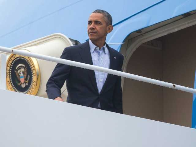 <p>President Barack Obama boards Air Force One for a trip to the COP21 climate change conference in Paris, on Sunday, Nov. 29, 2015, in Andrews Air Force Base, Md.</p>