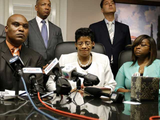 <p>Attorney Cannon Lambert, left, along with Sandra Bland's mother, Geneva Reed-Veal, center, and sister Sierra Cole hold a news conference, Tuesday, in Houston. Bland was found dead in a Texas county jail three days after a confrontation with a white state trooper. The family filed a wrongful-death lawsuit against the officer and other officials, saying it was a last resort after being unable to get enough information about the case.</p>