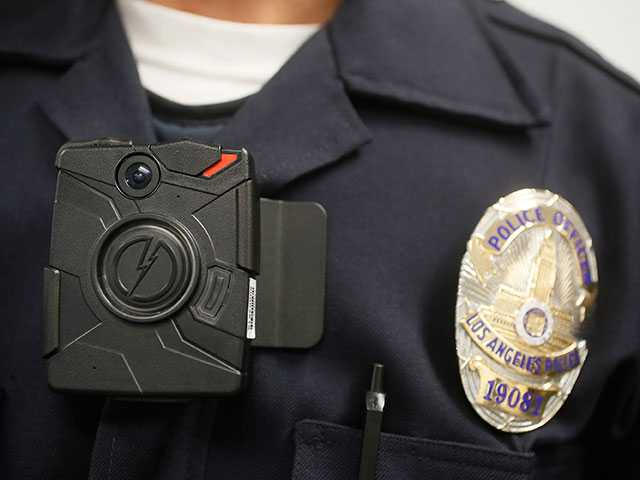 <p><span>A Los Angeles Police officer wears an on-body camera during a demonstration for media in Los Angeles. Some Los Angeles police officers are now equipped with the body cameras while on patrol. Police Commission President Steve Soboroff says that the first wave of 860 cameras has been rolled out to more than 100 Mission Division officers who patrol the San Fernando Valley.</span></p>
