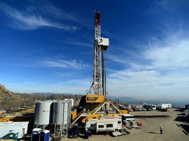 "<p><span style=""font-size: 10px;""><span style=""font-size: 12px;"">In this Dec. 9, 2015, pool file photo, crews work on stopping a gas leak at a relief well at the Aliso Canyon facility. The leak has finally been plugged.</span> </span></p>"
