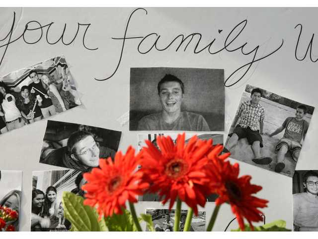 <p><span>images of Christopher Martinez are displayed in a memorial in front of the IV Deli Mart, where part of a mass shooting took place, near the University of California, Santa Barbara campus, in the Isla Vista beach community of Santa Barbara, Calif. His father, Richard Martinez, says he thinks of his son every day, and with those thoughts come the constant reminder of a young life cut tragically short by one of the nation's worst school killings.</span></p>