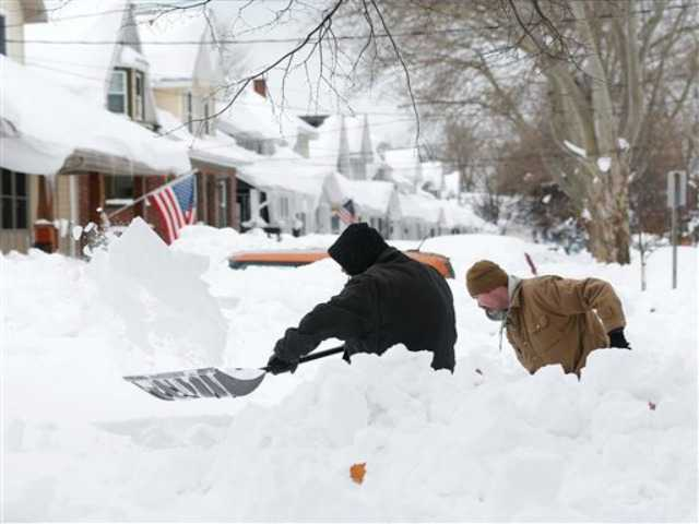 Cleanup on, flood threat looms after huge NY snow
